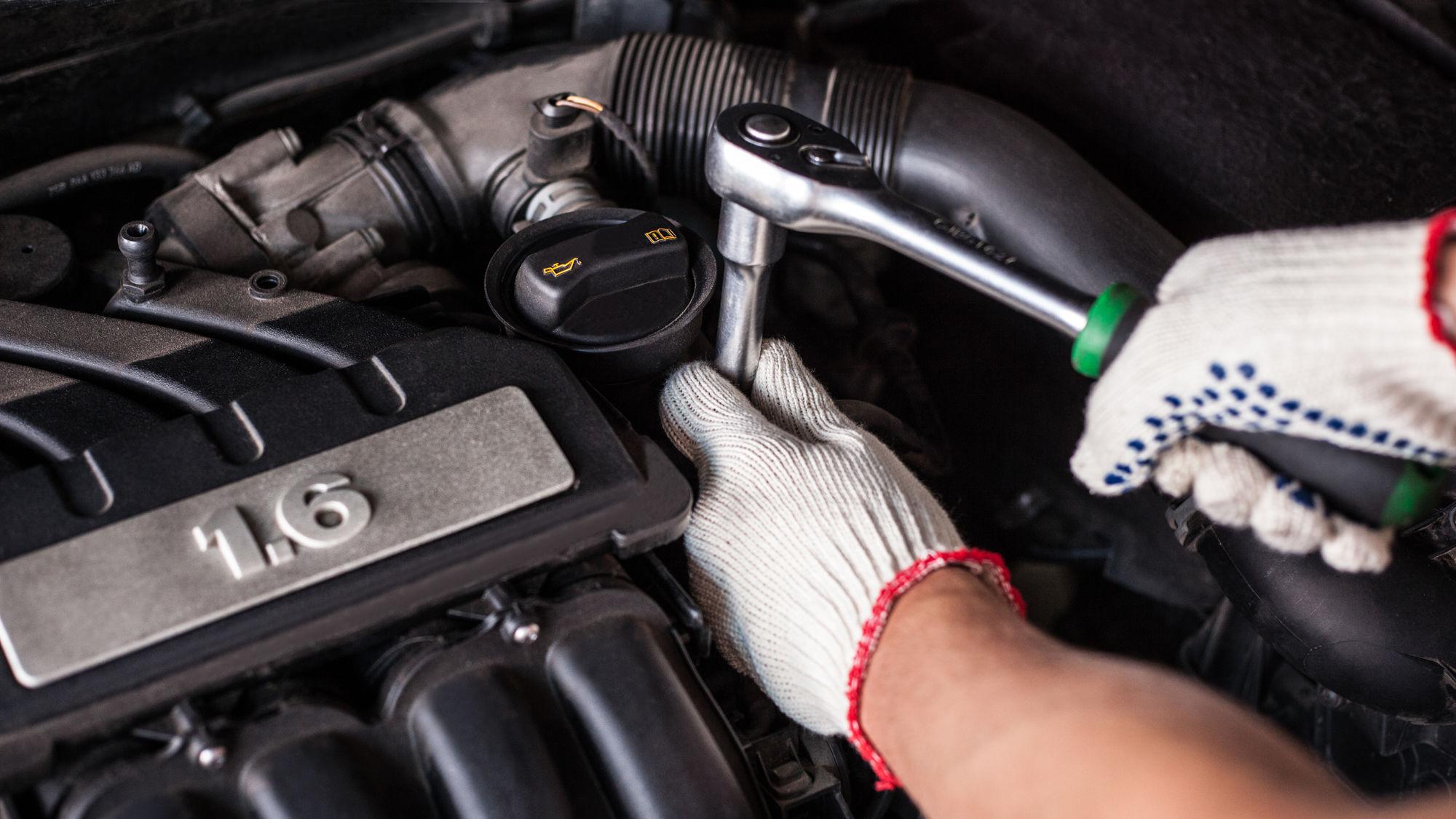 Car mechanic fixing an engine